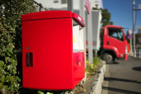 Tokyo, Japan-December 24, 2018: A red postbox in Japan