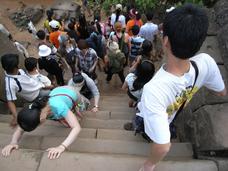 Siem Reap, Cambodia-March 9, 2008: Extremely steep staircase at Phnom Bakheng, Angkor, at year 2008. Since the stair was replaced by decent wooden one with railing on it, nobody can enjoy this thrill any more.