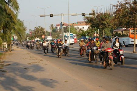Siem Reap, Cambodia-Januay 13, 2019: Motorcycles on National Highway 6 in Siem Reap, Cambodia, and in the morning Editöryel
