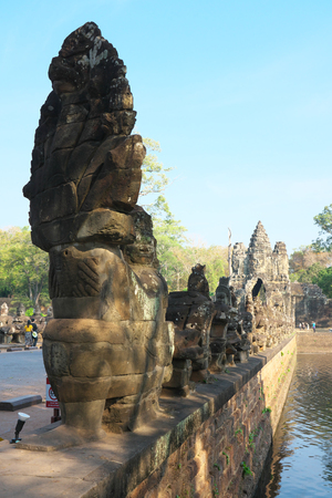 Siem Reap, Cambodia-Januay 11, 2019: Naga and demons on the bridge of the south gate of Angkor Thom, Siem Reap, Cambodia