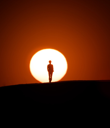 Tokyo, Japan-March 11, 2019: A silhouette of person on a hill at sunset