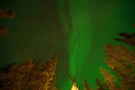 Yellowknife, Canada-August, 2019: Aurora borealis or Northern lights observed in Yellowknife, Canada, on August, 2019