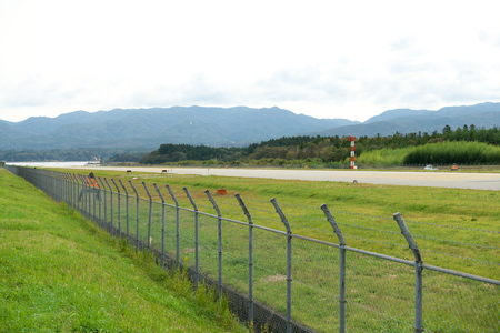 Niigata,Japan-October 22, 2019: Sado airport fence in Sado island, Niigata, Japan. Its operation is indefinite suspended. Stock Photo - 132886332