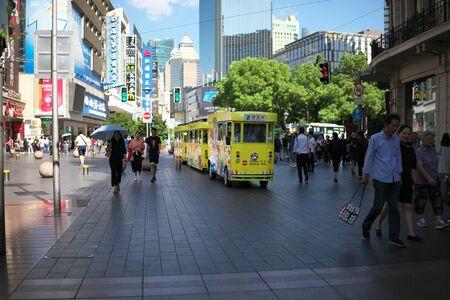 Shanghai,China-September 18, 2019: Sightseeing bus or train passing Nanjing East Road in Shanghai 写真素材 - 133366754