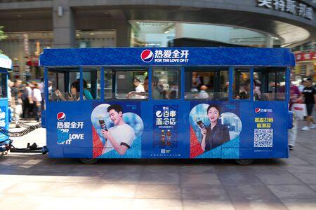 Shanghai,China-September 18, 2019: Sightseeing bus or train passing Nanjing East Road in Shanghai 写真素材 - 133366758