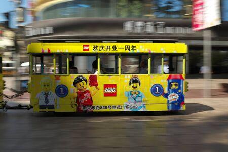 Shanghai,China-September 18, 2019: Sightseeing bus or train passing Nanjing East Road in Shanghai