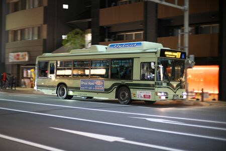 Kyoto,Japan-November 14, 2019: Panning of Kyoto City Bus on Shijo street in Kyoto 写真素材 - 133985028