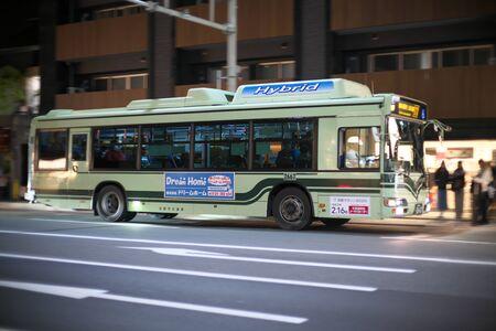 Kyoto,Japan-November 14, 2019: Panning of Kyoto City Bus on Shijo street in Kyoto 報道画像