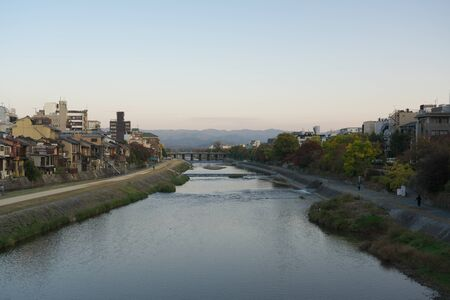 Kyoto,Japan-November 16, 2019: Kamo River in Kyoto Viewed from Shijo Bridge in the Morning 写真素材 - 133998340