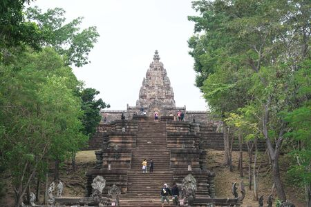 Buriram,Thailand-December 8, 2019: Approach and tower of Phnom Rung, Burirams Khmer temple on volcano, in Thailand