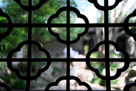 Suzhou,China-September 14, 2019: Lattice window or ornamental window in LiuYuan garden or Lingering garden, one of the wor ld heritage in Suzhou, China 写真素材 - 136267003