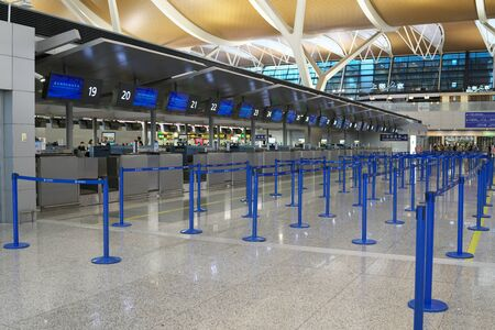 Shanghai,China-September 19, 2019: No people at Shanghai Pudong international airport second terminal check-in counters