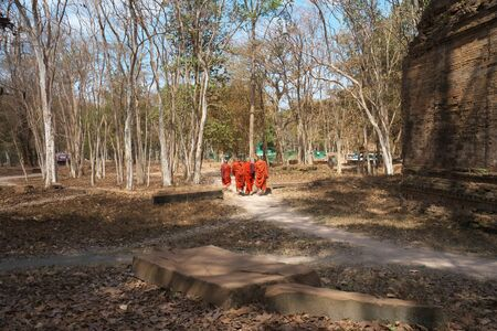 Kampong Thom, Cambodia-January 25, 2020: Four Monks walking by Prasat Sambor N9 of Sambor Prei Kuk in Kampong Thom, Cambodia
