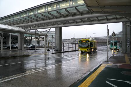 Narita,Japan-January 28, 2020: Free Shuttle Bus Connecting Terminals at Narita International Airport in the Rain