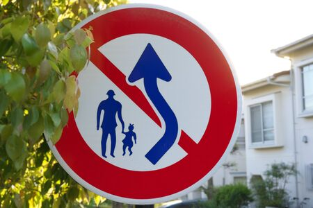 Road sign of no overtaking or passing pedestrians in Tokyo, Japan