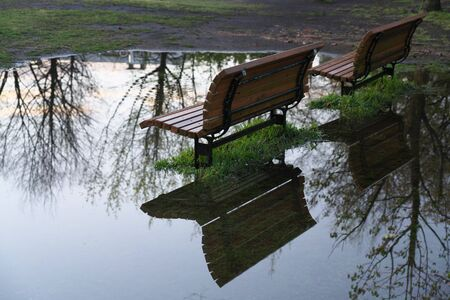 Tokyo, Japan-April 15, 2020: Benches in a puddle after the heavy rain in the morning in Tokyo, Japan
