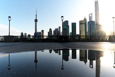 Shanghai,China-September 18, 2019: Reflection of Pudong New Area buildings on a pool of water after the morning rain in Shanghai Editorial