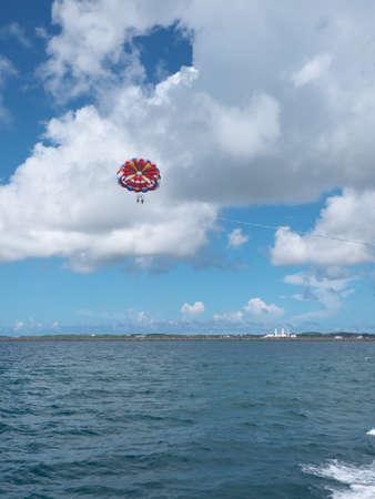 Parasailing on blue sky background at Miyakojima island