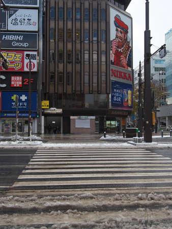 Hokkaido,Japan-November 11, 2020: Snow covering Susukino intersection, the most busy area in Sapporo City, Hokkaido