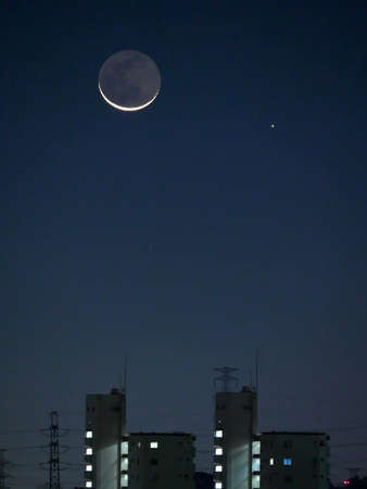 Tokyo,Japan-November 14, 2020: The moon with earthshine and the Mercury at dawn 写真素材