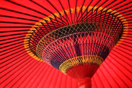 A Japanese tradition red bamboo-and-paper umbrella or Karakasa or Bankasa