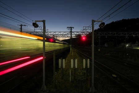 Kyoto,Japan-November 21, 2020: A train passing a station at dusk in Kyoto