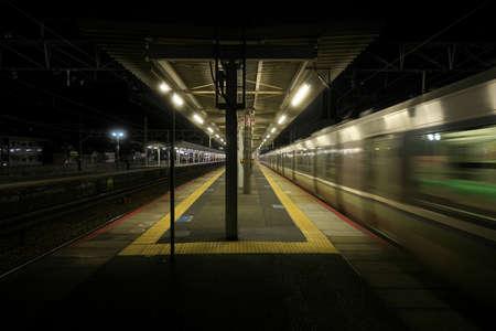 Kyoto,Japan-November 21, 2020: A train passing JR Yamashina station at dusk in Kyoto