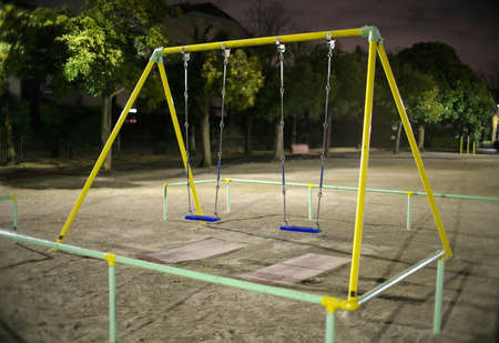 Tokyo,Japan-February 13, 2021: Vacant swing in a park at night in Tokyo 写真素材