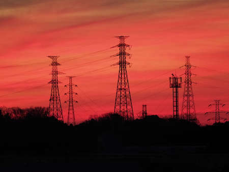 Tokyo,Japan-February 10, 2021: Silhouette of power line at dawn in Tokyo