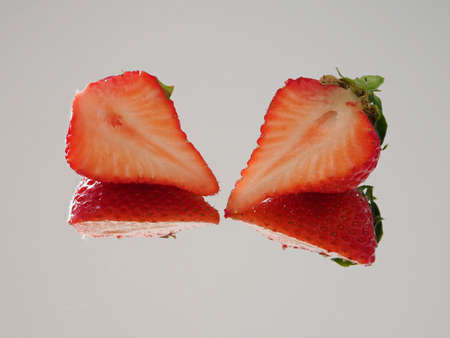 Closeup of slice of Japanese strawberry on white background 写真素材