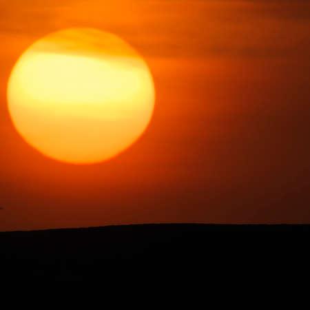 Tokyo,Japan-March 11, 2021: The sinking sun beyond a hill