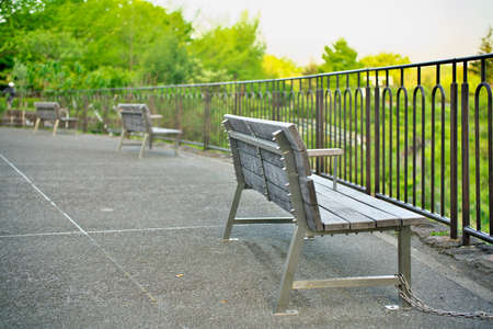 empty benches on a hill