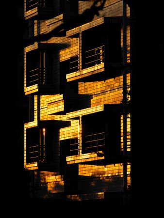 Wall of condo in the rising sun