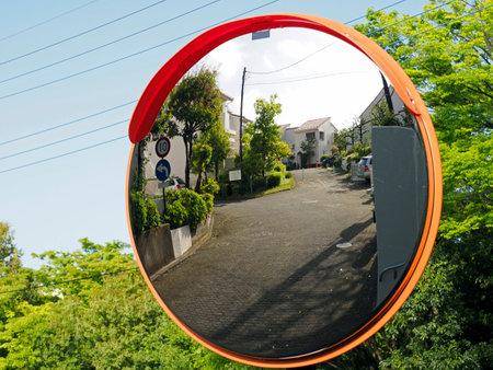 Convex traffic mirror at a road curve in Tokyo, Japan Фото со стока