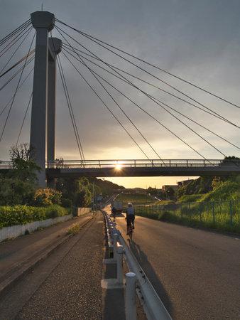 Tokyo,Japan-May 3, 2021: Ipponsugi-bashi bridge at sunrise in Tama city, Tokyo, Japan Фото со стока
