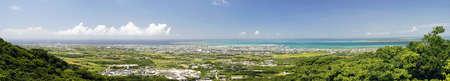 Okinawa,Japan - May 24, 2021: Panoramic view of Ishigaki City and Ishigaki port, Okinawa, Japan, from Banna park