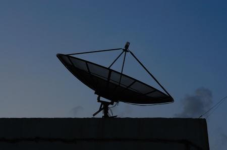 Black satellite dish on office building Stock Photo - 13201919