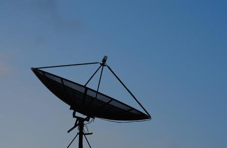 Black satellite on Blue sky photo