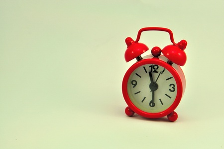 Red clock isolated on white background  photo