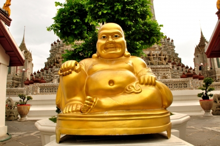 Smiling Golden Buddha Statue, Chinese God of Happiness, Wealth and Lucky Isolated on white photo