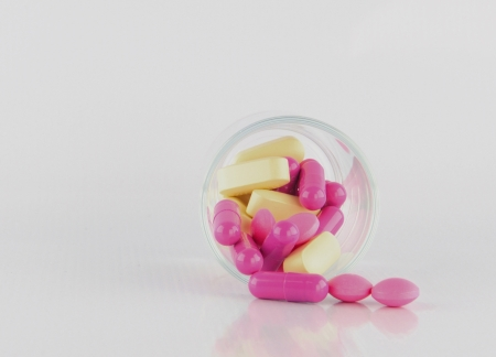 Tablet and capsule in prescription glass show medicine time Stock Photo - 16654391