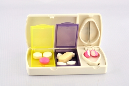 Pill box and split blade show medicine concept Stock Photo - 17074851