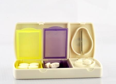 pill box: Pill box and split blade show medicine concept Stock Photo