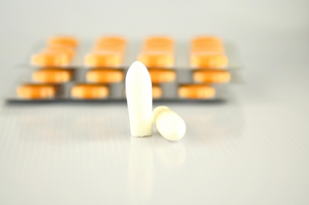 Suppositories tablet and blister pack show medicine background