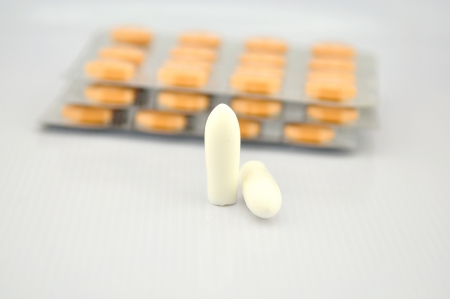 Suppositories tablet and blister pack show medicine background Stock Photo - 18302285
