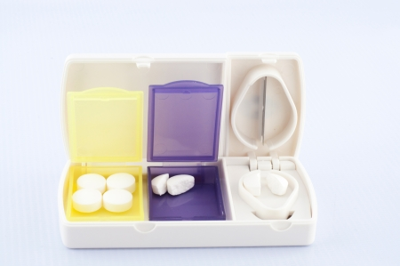 Pill box and split blade tablet show medicine concept Stock Photo - 18848196