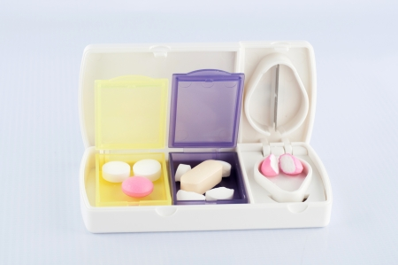 Pill box and split blade tablet show medicine concept photo