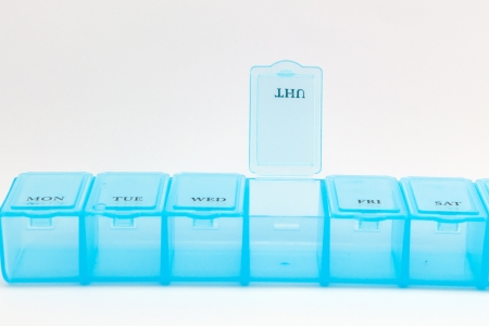 pill box: Closed up daily pill box show medicine equipment