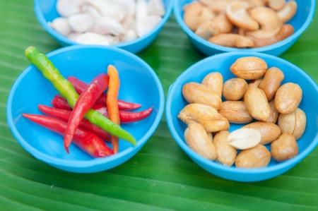 ingradient: chilli garlic and bean on green leaf show ingradient of Thai food