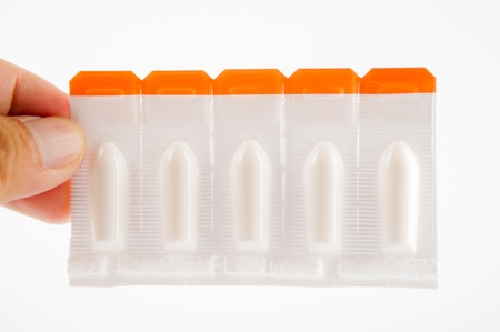 urethral: Suppository tablet on white background